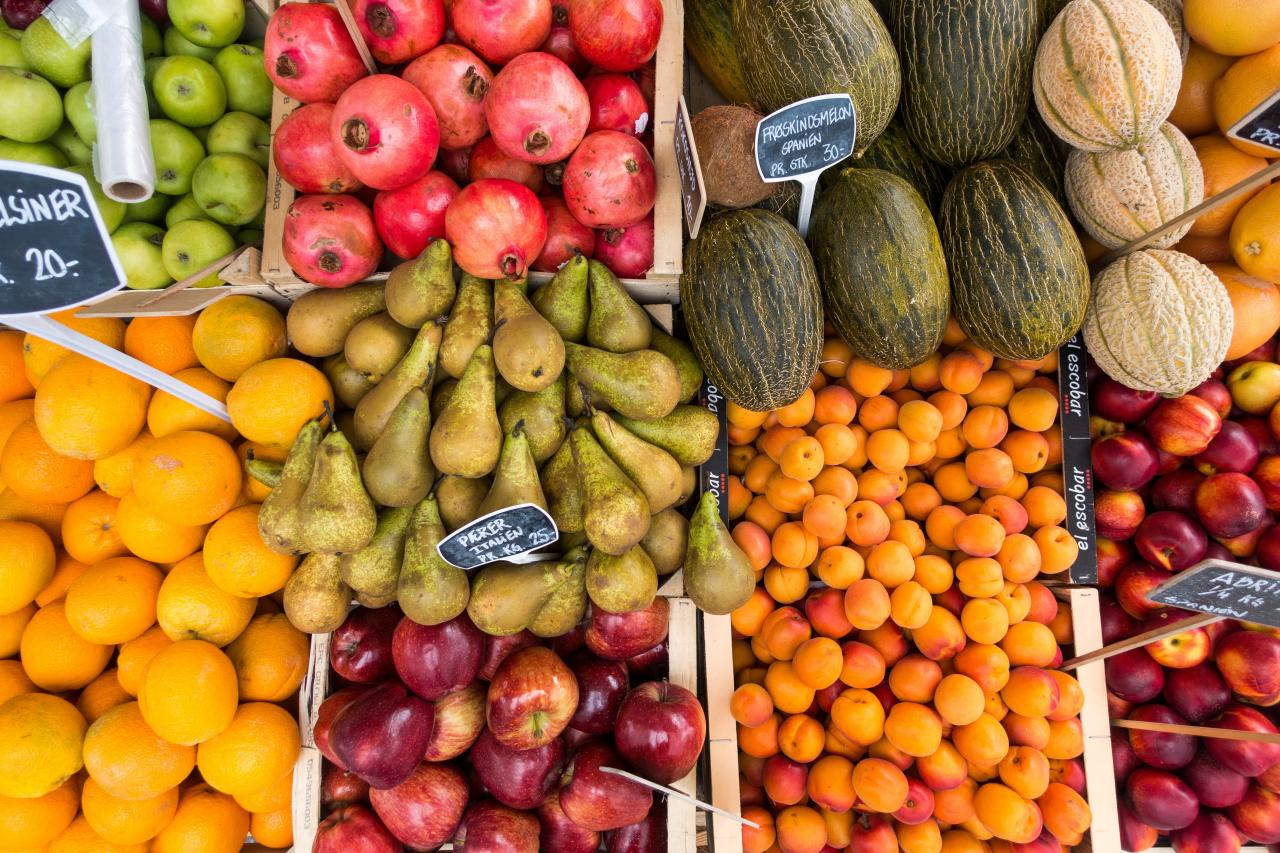 Overhead photograph of various fruit at a market.